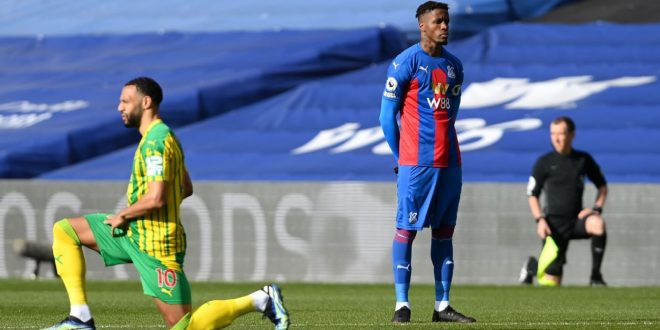 Zaha first PL player to not kneel before a match