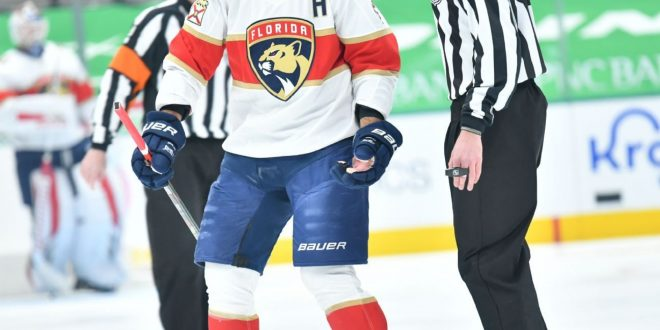 Panthers' Ekblad (leg) taken off ice on stretcher