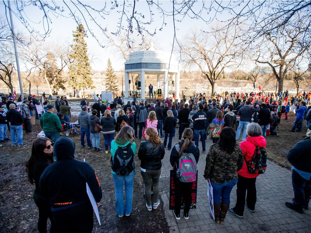People gathered at Vimy Memorial to protest mandatory mask laws and the government's handling of the COVID-19 pandemic. Photo taken in Saskatoon, SK on Saturday, March 20, 2021.