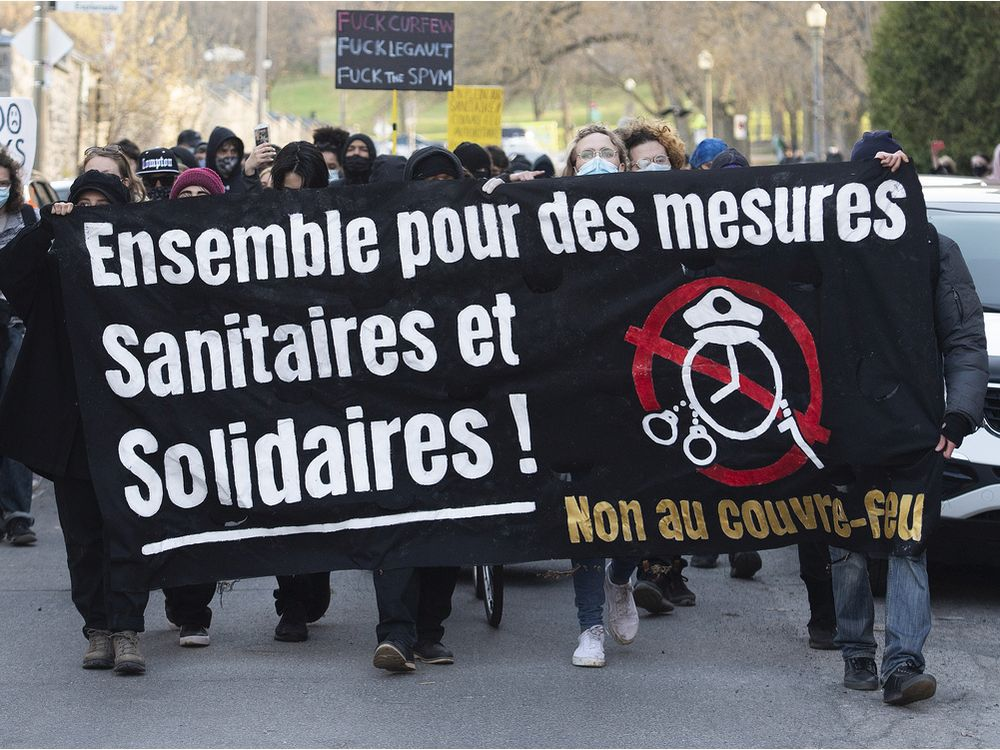 People take part in a demonstration opposing the Quebec government's 8 p.m. curfew in Montreal, Sunday, April 18, 2021.