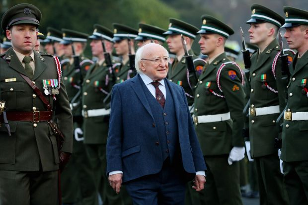 resident Michael D Higgins inspects the Guard of Honor before he departs for a 2018 state visit to Greece. Photograph: Maxwells