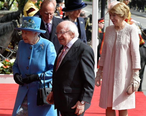 President Michael D Higgins with Queen Elizabeth and his wife Sabina at Windsor Castle during a State visit to Britain in 2014. Photograph: Toby Melville/Reuters