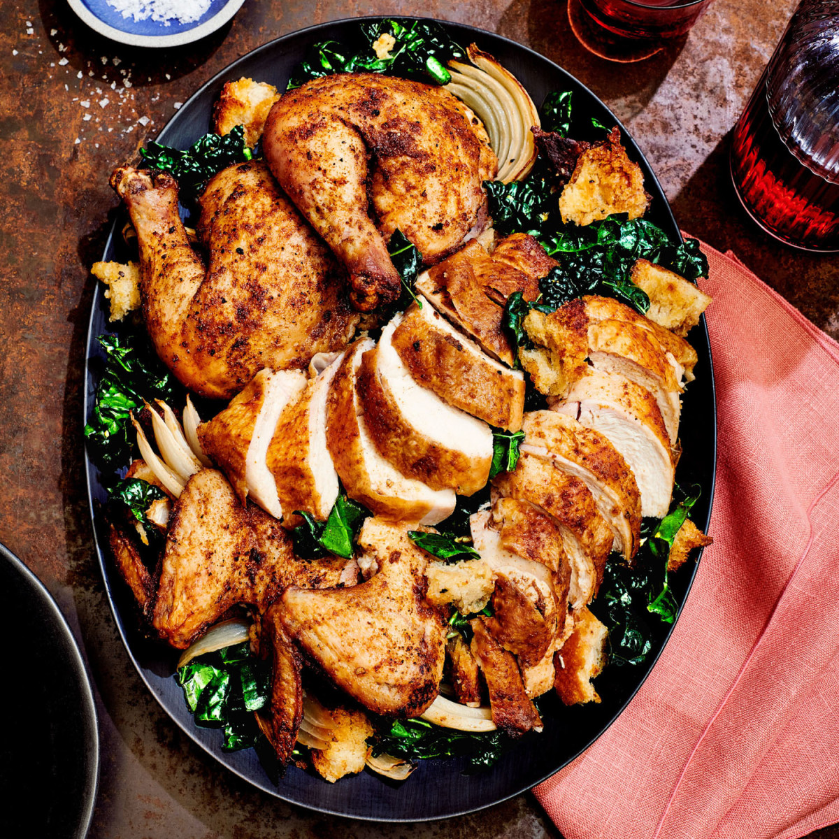 spice-rubbed butterflied roast chicken with kale salad and crunchy croutons