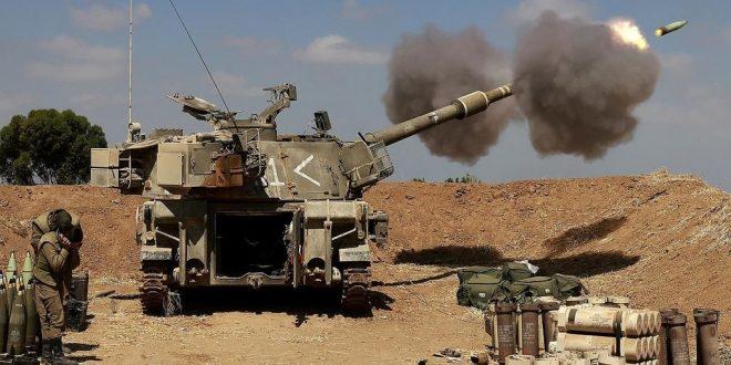 Israel masses troops along Gaza border amid rocket fire