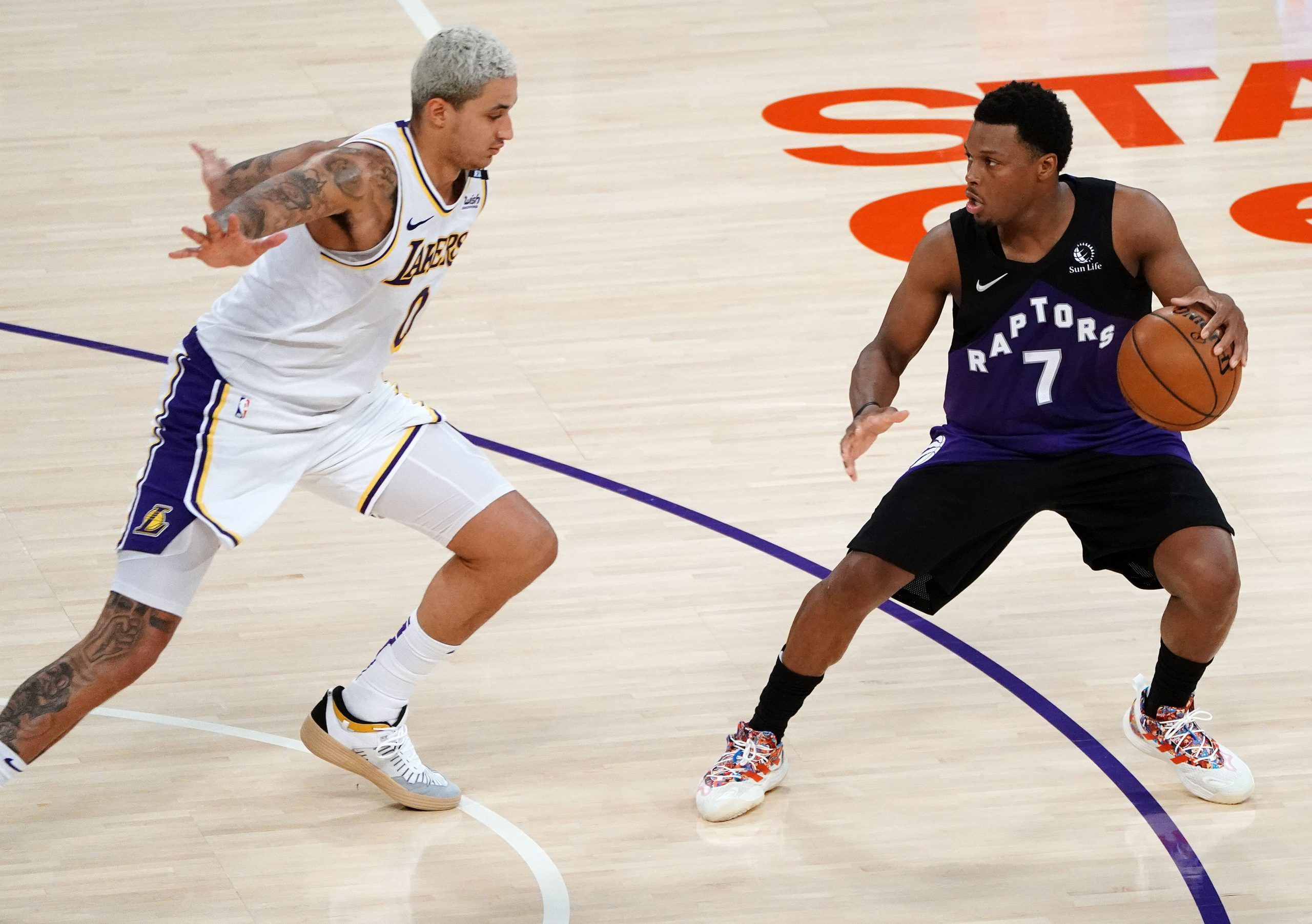 Toronto Raptors guard Kyle Lowry (7) controls the ball against Los Angeles Lakers forward Kyle Kuzma (0) during the second half at Staples Center May 2, 2021.