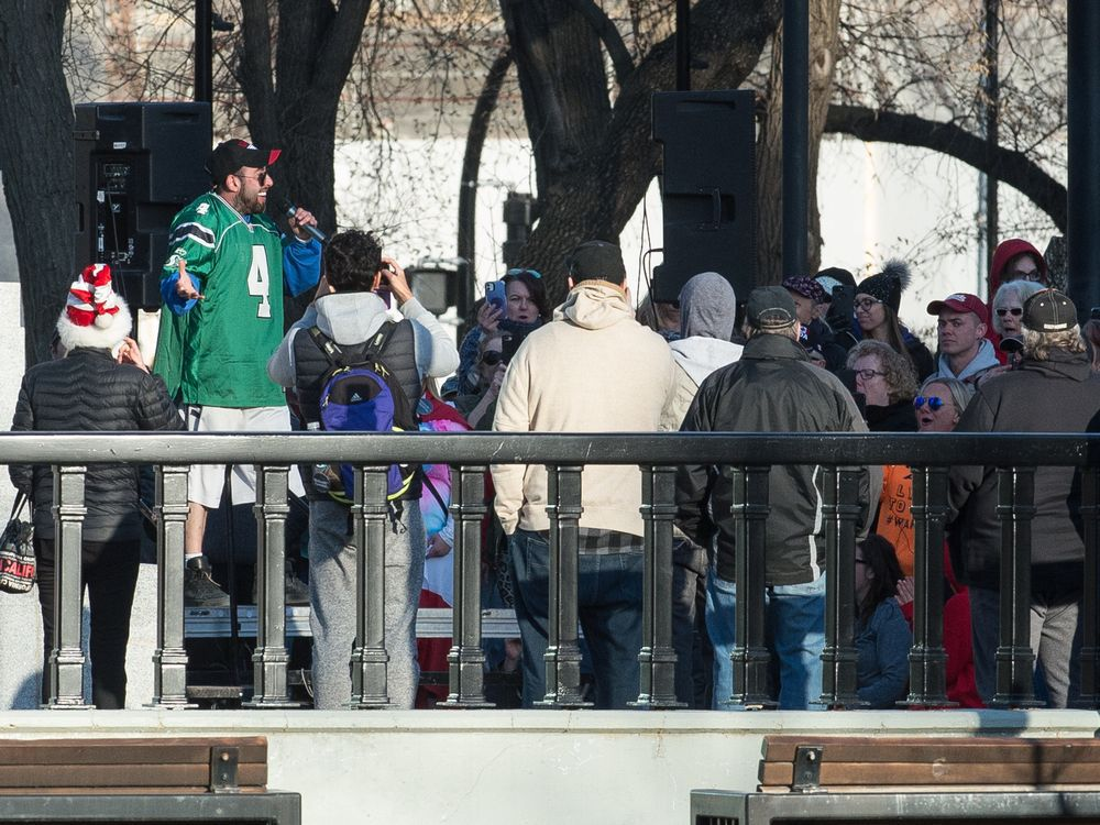 Anti-vaccine/anti-mask demonstrators are seen gathered at the cenotaph in Victoria Park in Regina, Saskatchewan on April 24, 2021. Speaker