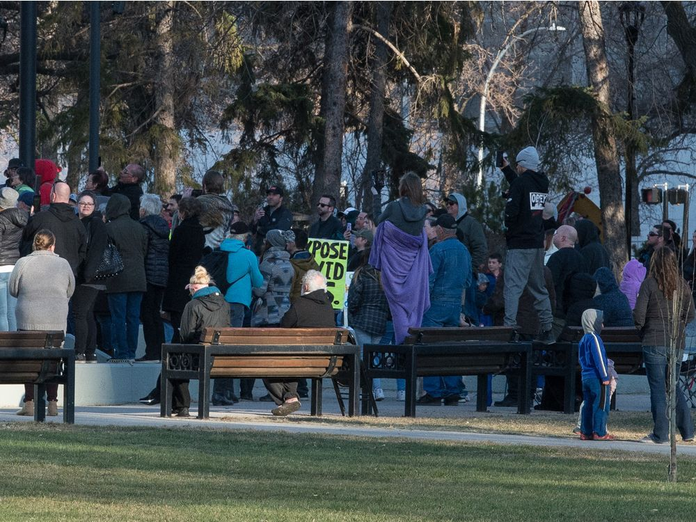 A large gathering of anti-vaccine/anti-mask demonstrators are seen gathered at the cenotaph in Victoria Park in Regina on April 24, 2021. During the rally a Regina man was charged with two counts of common assault and four tickets where handed out to rally attendants for violating public health orders.