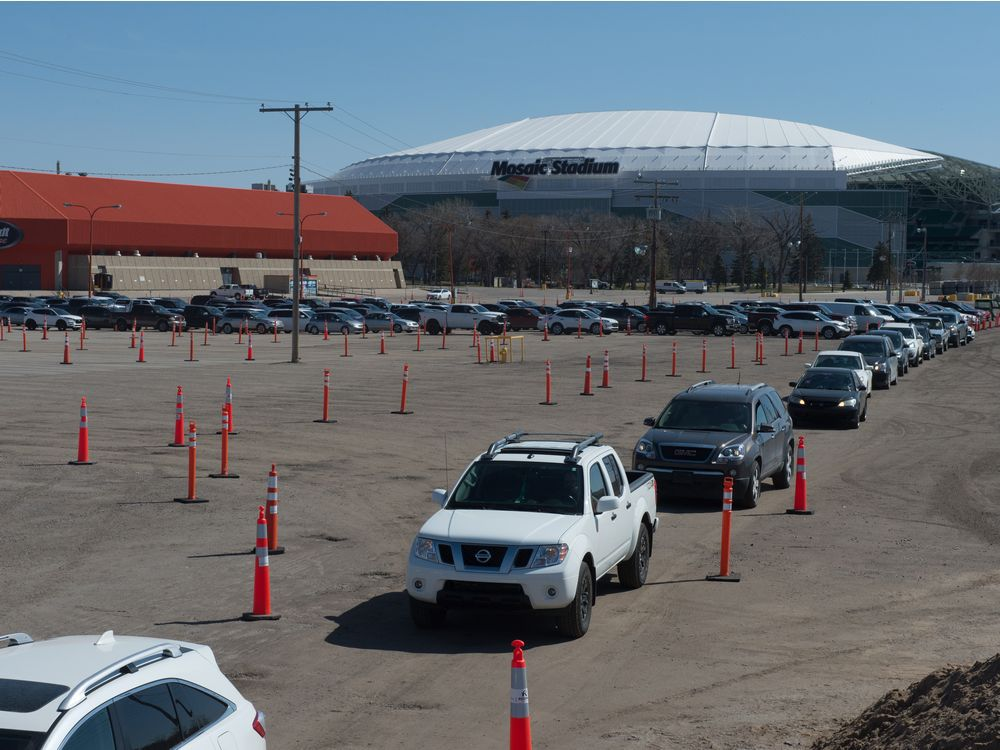 Vehicles line up for the drive-thru COVID-19 vaccine clinic at Evraz Place in Regina, Saskatchewan on May 4, 2021. Not everyone has access to drive-thru options, so alternatives, like walk-in clinics, are available.
