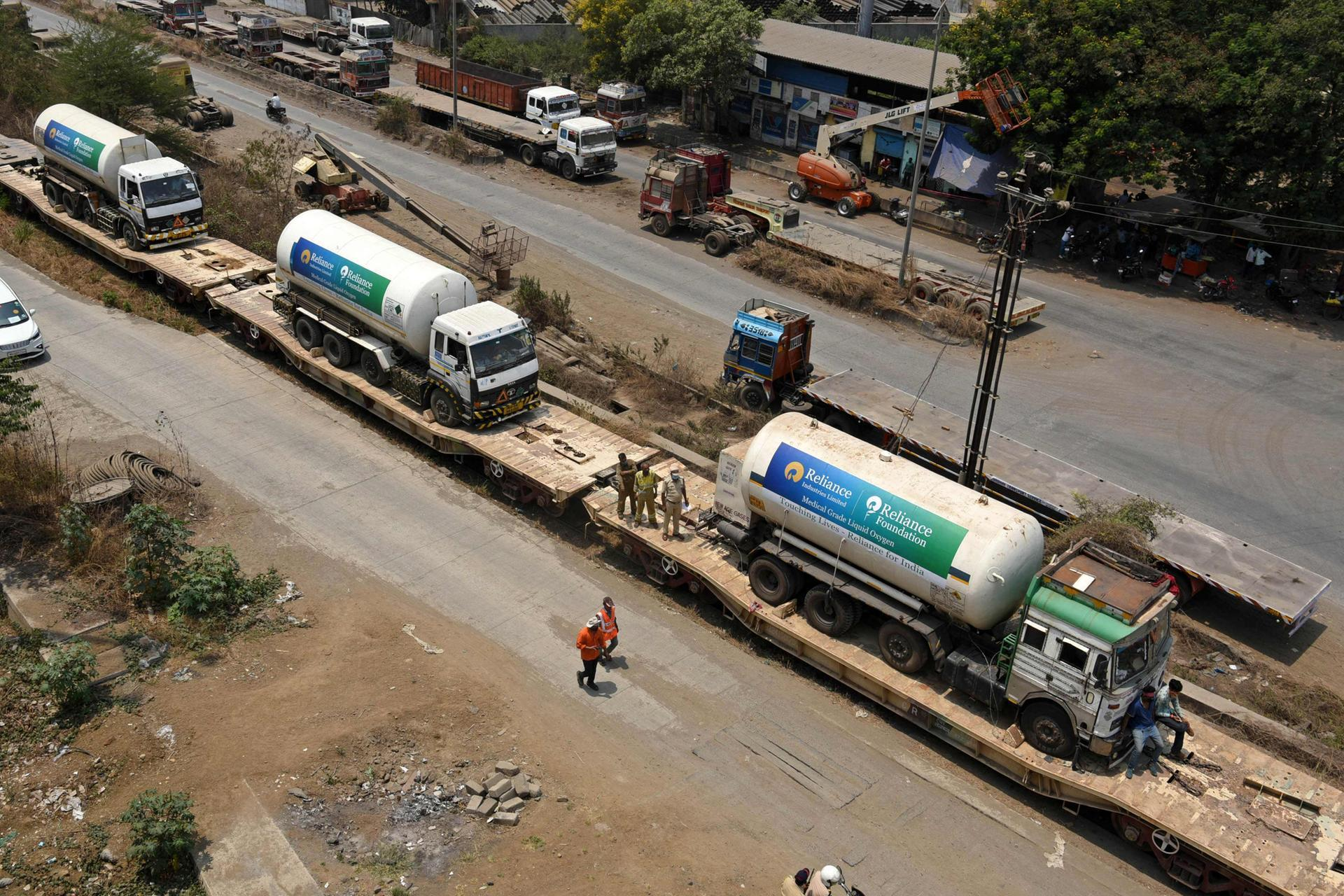 Oxygen tankers on board an 'Oxygen Express' train arrive in Navi Mumbai as India fights against a surge in Covid-19 cases.  AFP