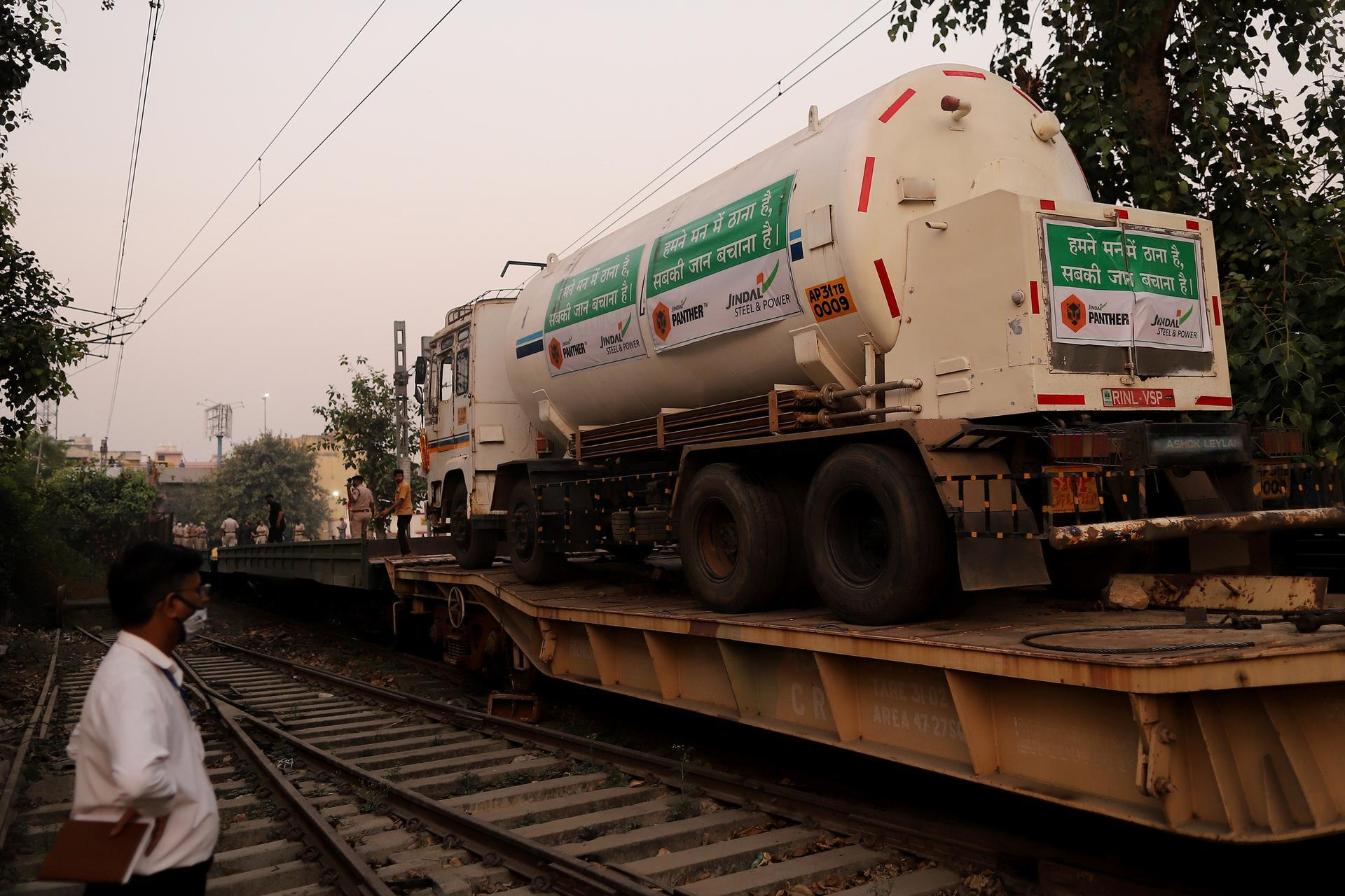 Medical oxygen tankers arrive at a train station in Delhi after being transported on a 'Oxygen Express' train. Bloomberg
