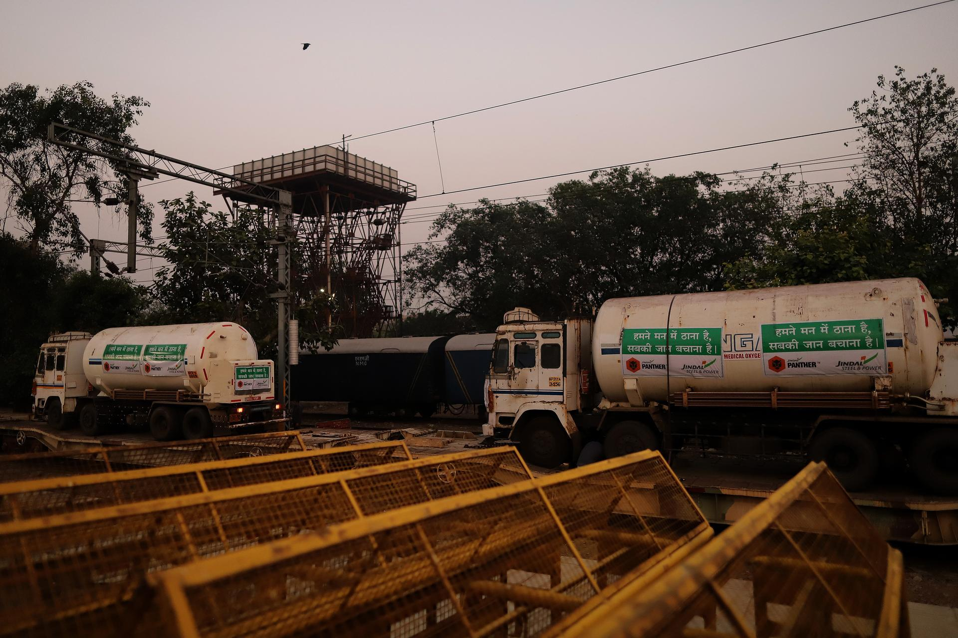 Medical oxygen tankers are delivered via the 'Oxygen Express' train to a Delhi railway station. Bloomberg