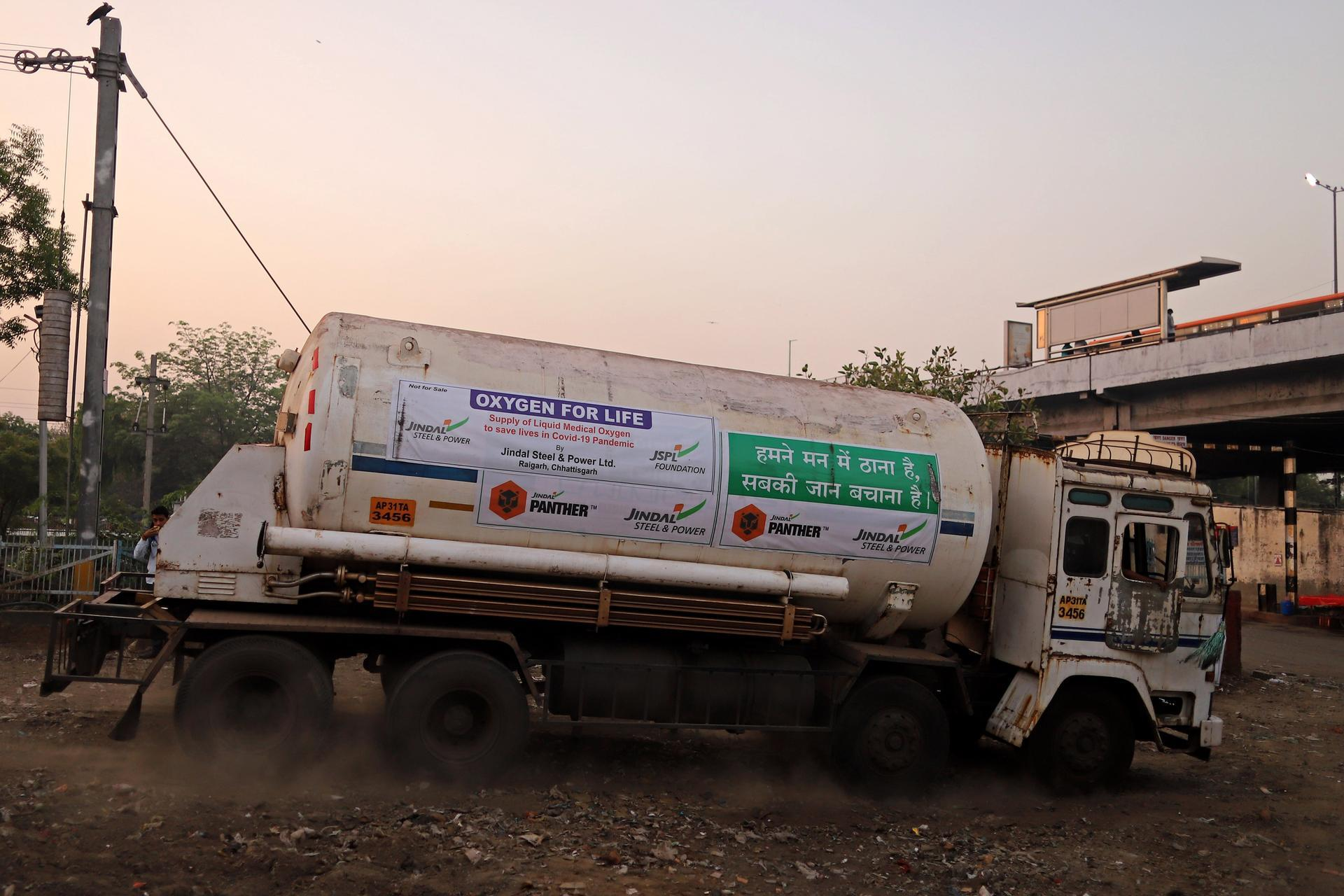 A tanker arrives in Delhi after being transported by rail. Bloomberg