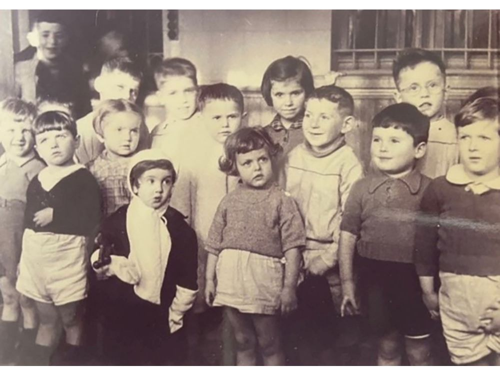 Waiting in a deportation camp in Second World War Brussels, from where Jewish people were sent to concentration and extermination camps in Eastern Europe, are a group of Jewish children under five, including (back row, second and third from left) Jacques Wengrowicz (later Jack Cohen) and four-year-old twin brother Leon Wengrowicz (later Leon Cohen). News of their plight reached Yvonne Nevejean, leader of the Children's National Care Authority in Belgium. The organization fought and saved the lives of some 150 children. The twins were flown to Canada in 1947 in a group of 1,116 youngsters and adopted by Edmonton's Harry and Lillian Cohen.