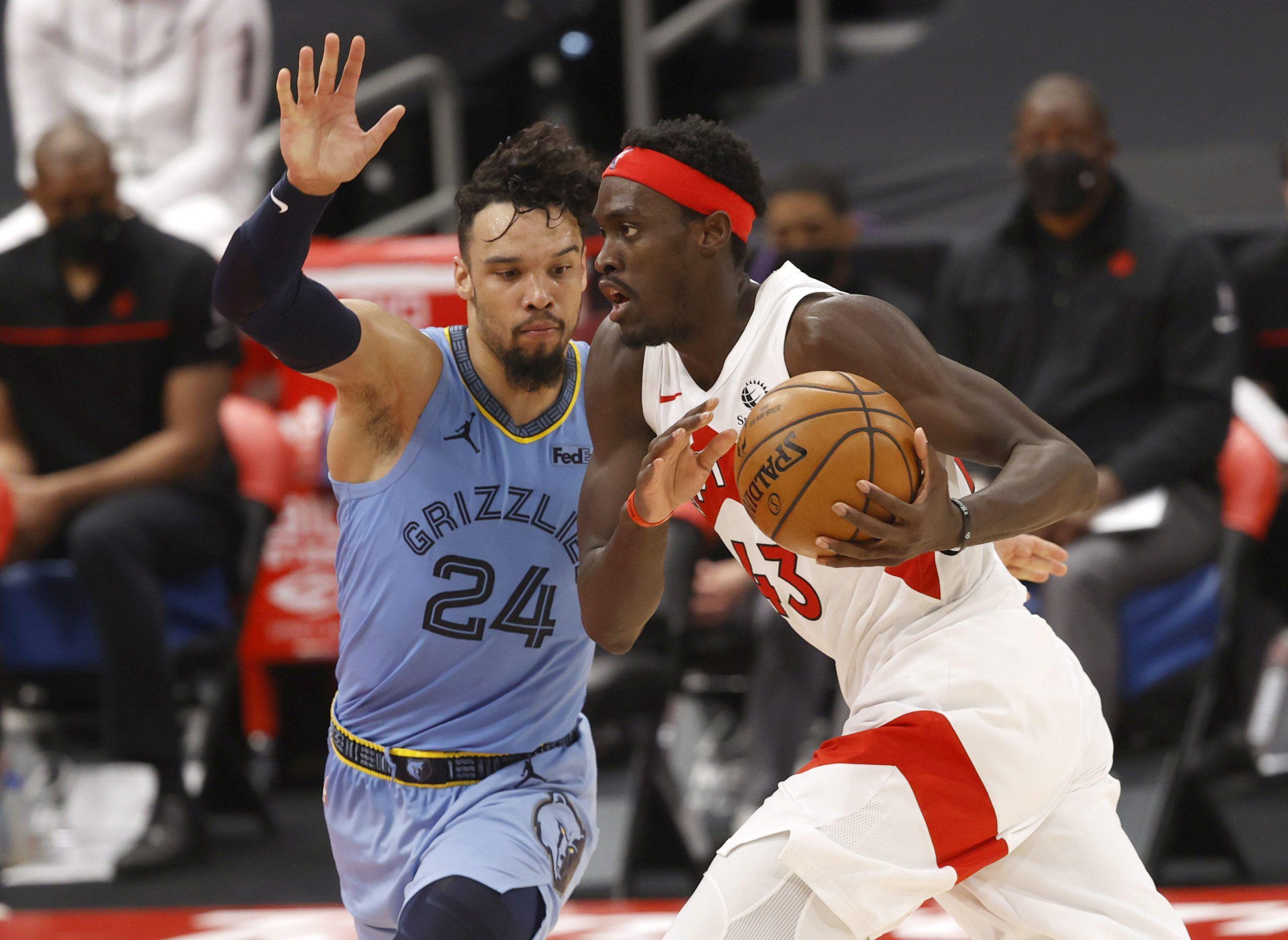 Toronto Raptors forward Pascal Siakam drives to the basket against Canadian Memphis Grizzlies forward Dillon Brooks.