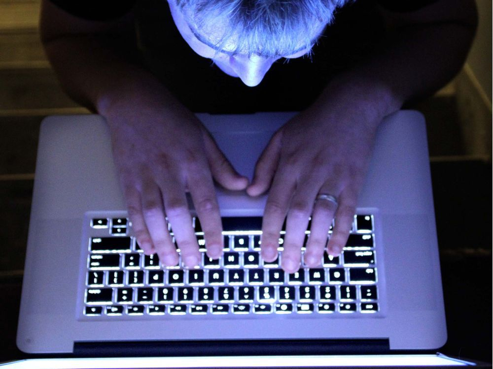A man looks at a computer screen.