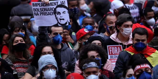 In photos: Brazilians rally against Bolsonaro as COVID deaths top 500,000