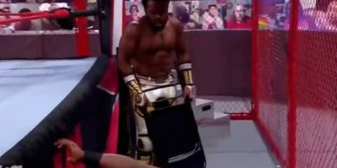 Xavier Woods beats Bobby Lashley with a steel chair in Hell in a Cell match