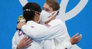 IOC reminds Olympians: No hugging on podium
